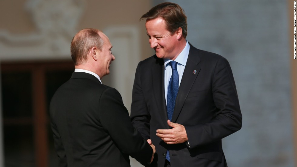 Russian President Vladimir Putin, left, and British Prime Minister David Cameron shake hands during an official welcome of G-20 heads of state and government at the Konstantin Palace in St. Petersburg.