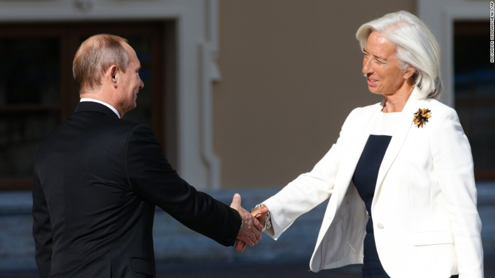 Putin, left, shakes hands with Christine Lagarde, managing director of the International Monetary Fund, during arrivals for the G-20 summit.