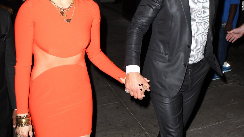 "Paula Patton and Robin Thicke show affection as they attend an album party for ""Blurred Lines"" in New York on September 4."