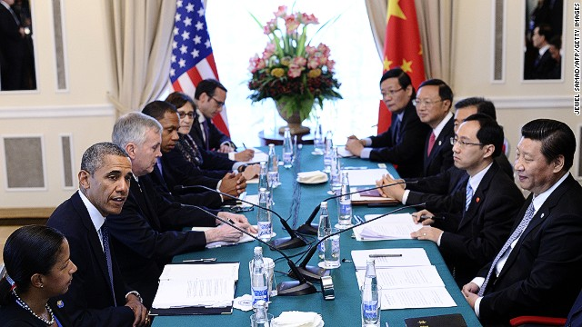 US President Barack Obama (2R) speaks during a bilateral meeting with Chinese President Xi Jinping (R) in Saint Petersburg on September 6, 2013 on the sideline of the G20 summit.
