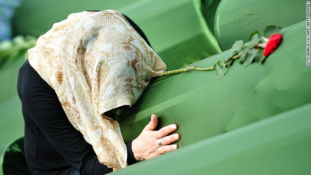 A survivor of Srebrenica 1995 massacre, mourns for her relatives at a cemetery in Potocari, Bosnia, on July 11, 2013.