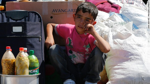Image #: 24196948    A Syrian boy sits beside his family's belongings as they wait for a vehicle to pick them up after entering Turkey from the Turkish Cilvegozu border gate, located opposite the Syrian commercial crossing point Bab al-Hawa, in Reyhanli, Hatay province, September 6, 2013. The U.N. refugee agency UNHCR said in a statement on Tuesday that a near tenfold increase over the past 12 months in the rate of refugees crossing Syria's borders into Turkey, Iraq, Jordan and Lebanon - to a daily average of nearly 5,000 men, women and children - had pushed the total living abroad above two million. REUTERS/Umit Bektas (TURKEY - Tags: POLITICS CIVIL UNREST SOCIETY IMMIGRATION)       REUTERS /UMIT BEKTAS /LANDOV