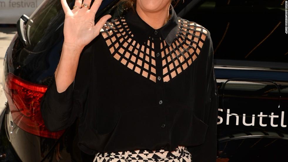 Kristen Wiig waves to the Toronto Film Festival crowd on September 6.