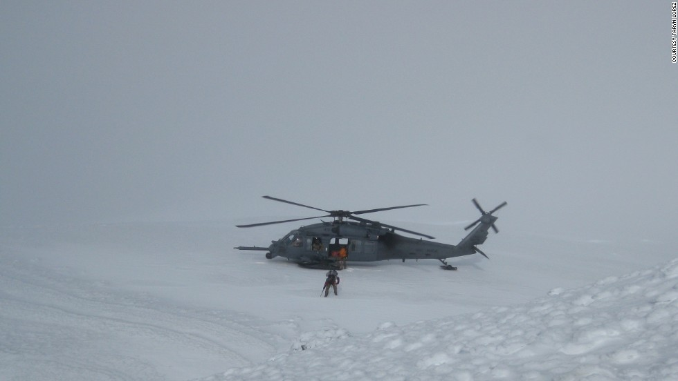 The Alaska Air Guard Rescue team arrives to scoop up the stranded team on Friday.