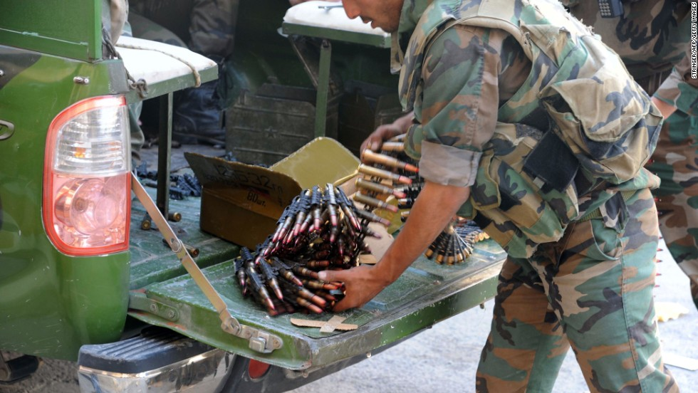 A Syrian soldier prepares large-caliber bullets for a machine gun in Maaloula on September 7.