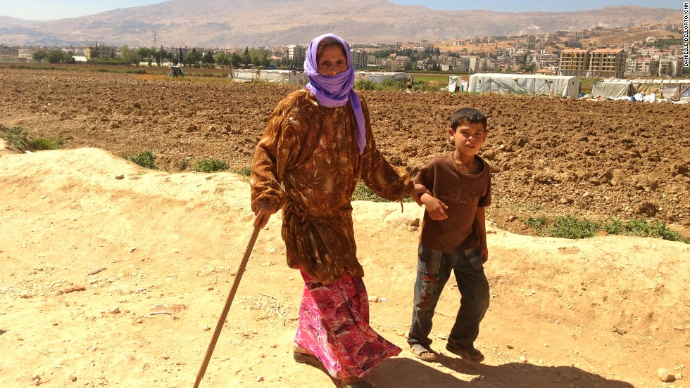 A Syrian looking for safety crosses the border into Lebanon every 15 seconds. Most of the children can be found without their parents, who stay in Syria to work and protect their homes. This boy, age 9, walks with his grandmother back to their tent. He told Gupta's producer, Danielle Dellorto, that he asks every day if they can go back home to Syria.