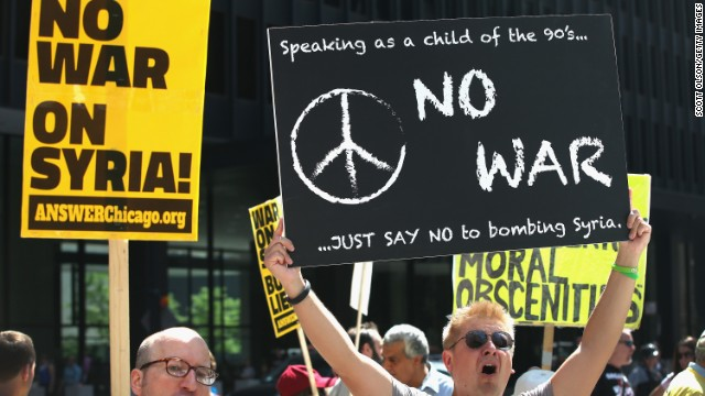 CHICAGO, IL - SEPTEMBER 07: Justin Uebelhor (L) and Jerry Ricd participate in a protest against U.S. intervention in Syria on September 7, 2013 in Chicago, Illinois. President Barack Obama has sought congressional approval to attack Syria in response to allegations that the Syrian regime had used chemical weapons on their own people. (Photo by Scott Olson/Getty Images)