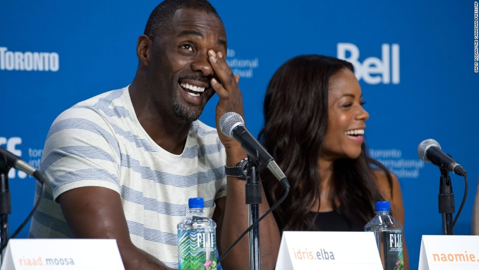 "Actors Idris Elba and Naomie Harris appear at the press conference for ""Mandela: Long Walk to Freedom"" on September 8."