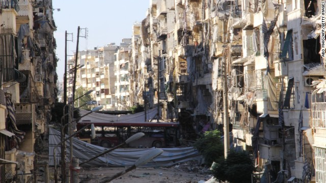 A picture shows heavily damaged buildings in the Salah al-Din area of the northern Syrian city of Aleppo on September 8, 2013. Syrian President Bashar al-Assad has denied he was behind a chemical attack last month and called on lawmakers to reject planned US military strikes warning of possible retaliation, CBS television said. AFP PHOTO / ABO MHIO        (Photo credit should read ABO MHIO/AFP/Getty Images)