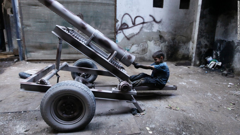 Ten-year-old Issa works with his father making weapons in a factory for the Free Syrian Army in Aleppo. Issa works 10-hour days, every day but Friday.