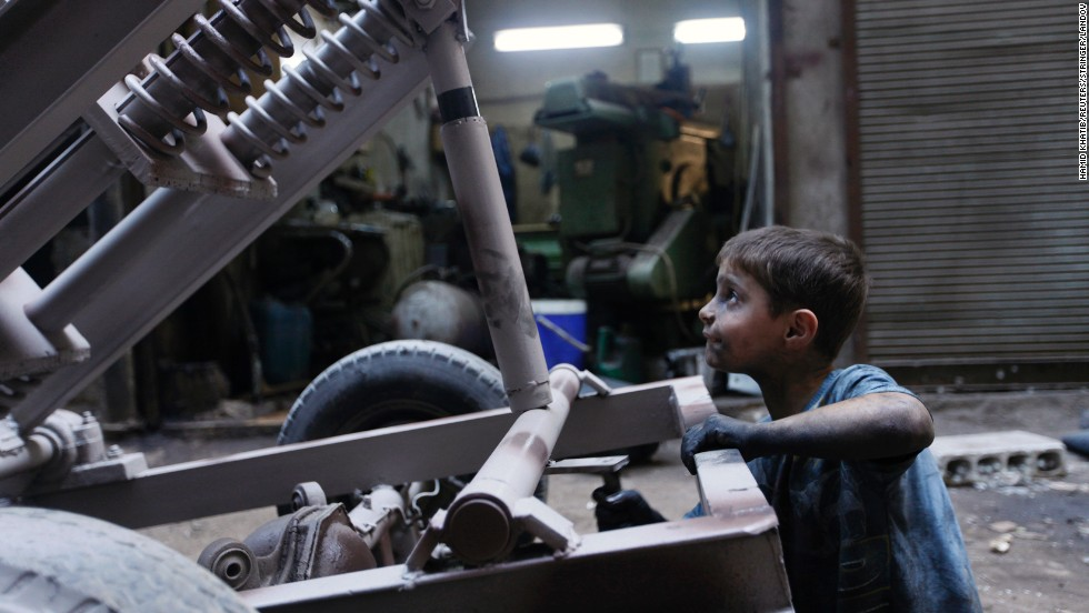 Issa fixes a mortar launcher in a Free Syrian Army weapons factory in Aleppo.