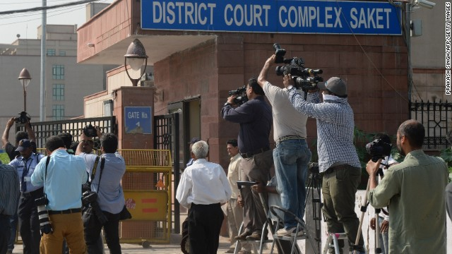 Photojournalists take pictures of a Delhi police van believed to be carrying the accused in a gangrape case as it enters Saket Court Complex in New Delhi on September 10, 2013. A judge is expected to hand down a verdict on four men accused of the fatal gang-rape of an Indian student on a bus, which could see the defendants sentenced to death. The parents of the popular physiotherapy student have been at the forefront of calls for the four to be hanged over the December 16 attack in New Delhi which triggered mass protests as well as new anti-rape laws.