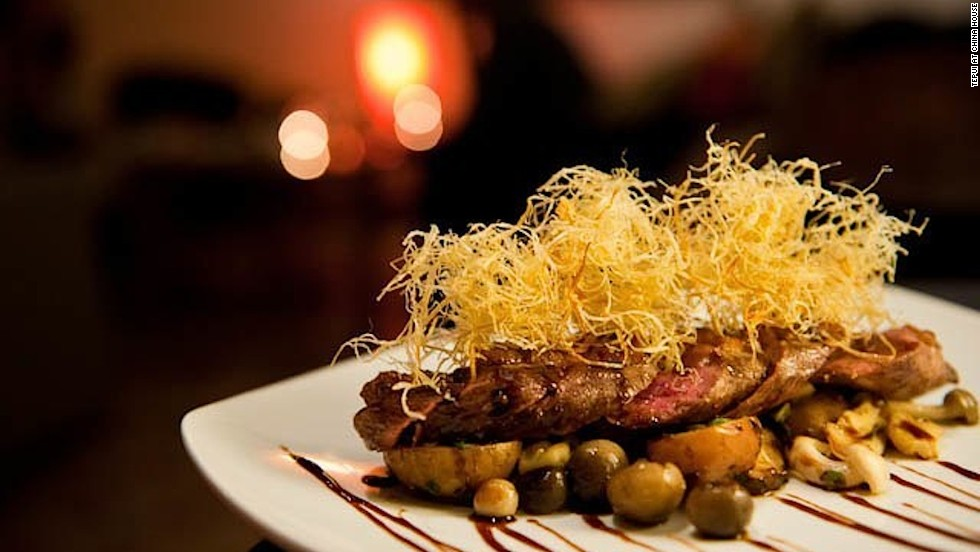 Phnom Penh is gaining a reputation for fine dining. The menu at popular Tepui at China House is influenced by Mediterranean and South American cuisine. Head chef Gisela Salazar Golding is Venezuelan. Pictured: duck breast in a bed of mushrooms with baby potatoes.