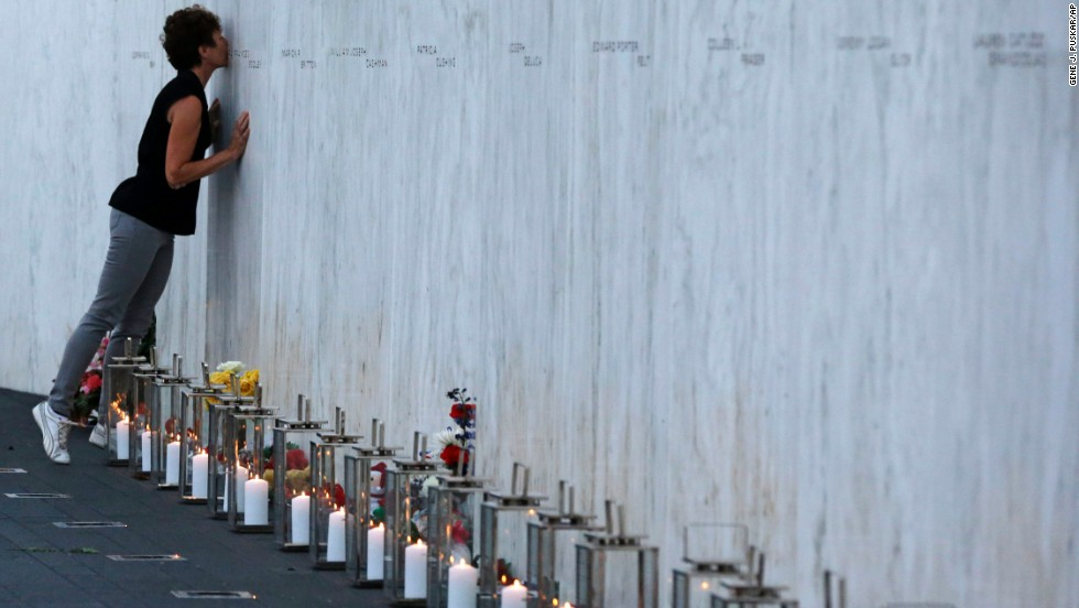 A woman kisses one of the 40 names on the Flight 93 National Memorial wall in Shanksville, Pennsylvania, on September 10. United Airlines Flight 93 crashed into a field near Shanksville on 9/11.