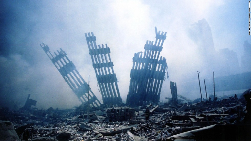 The rubble of the World Trade Center in New York City smolders following the terrorist attack on September 11, 2001.