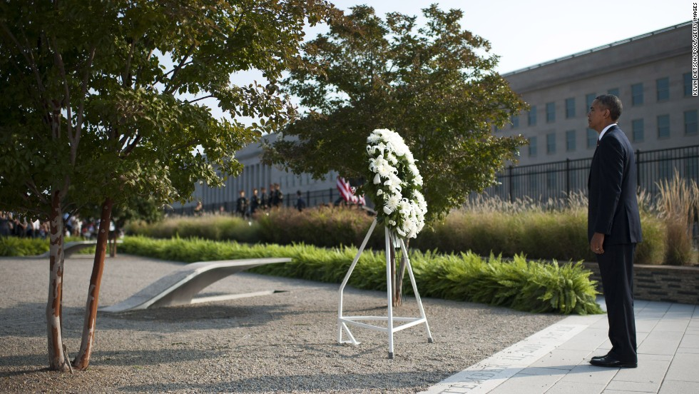President Barack Obama listens to military taps after laying a wreath at the Pentagon in Arlington, Virginia, on September 11.