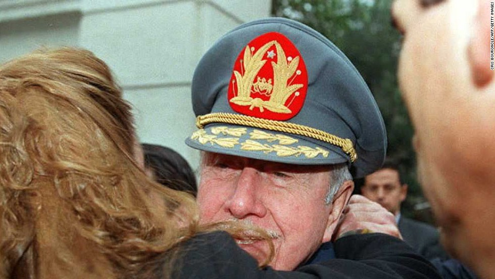 Pinochet is greeted by a supporter on August 23, 1995 after leaving his house in Santiago to celebrate his 22nd anniversary as commander with military ceremonies.