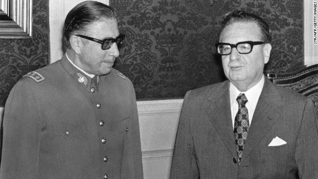 Santiago, CHILE: (FILE) Picture taken 23 August 1973 showing general Augusto Pinochet (L) posing with Chilean President Salvador Allende in Santiago, shortly after Allende appointed him head of the army - just three weeks before Pinochet's coup against Allende. Pinochet, 91, died 10 December, 2006 at the Military Hospital in Santiago, where he was admitted a week ago following a heart attack. Accused of fraud and human rights abuses during his regime, Pinochet was first ordered under house arrest in late October on other charges only to be released on parole a few days later in deference to his advanced age and ill health.