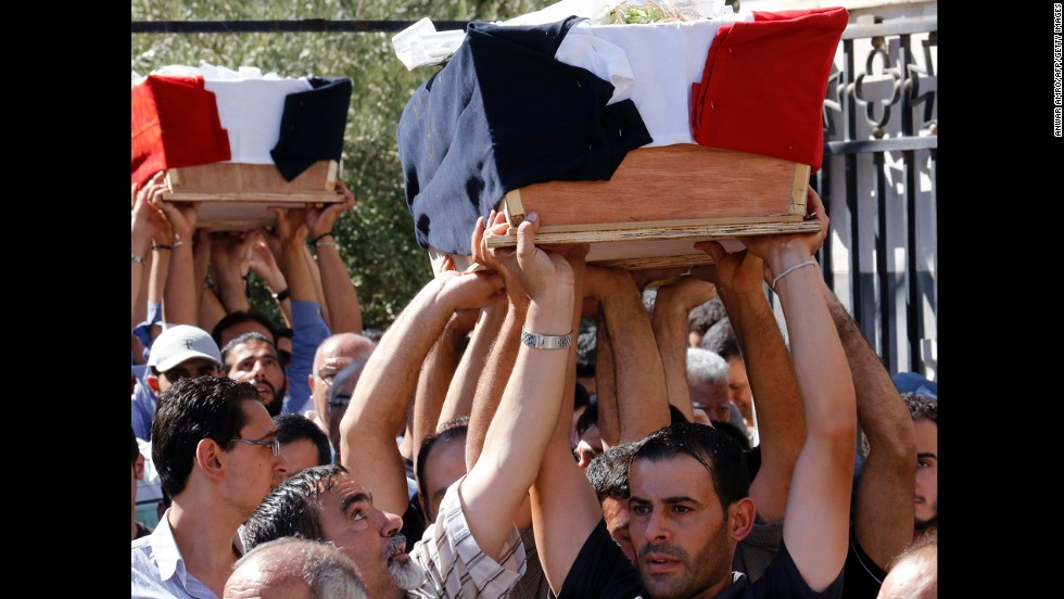 A funeral is held on September 11 for three Christian Syrians killed during battles with an al Qaeda-linked rebel group that took control of the historic Christian town of Maaloula from regime forces during the weekend.