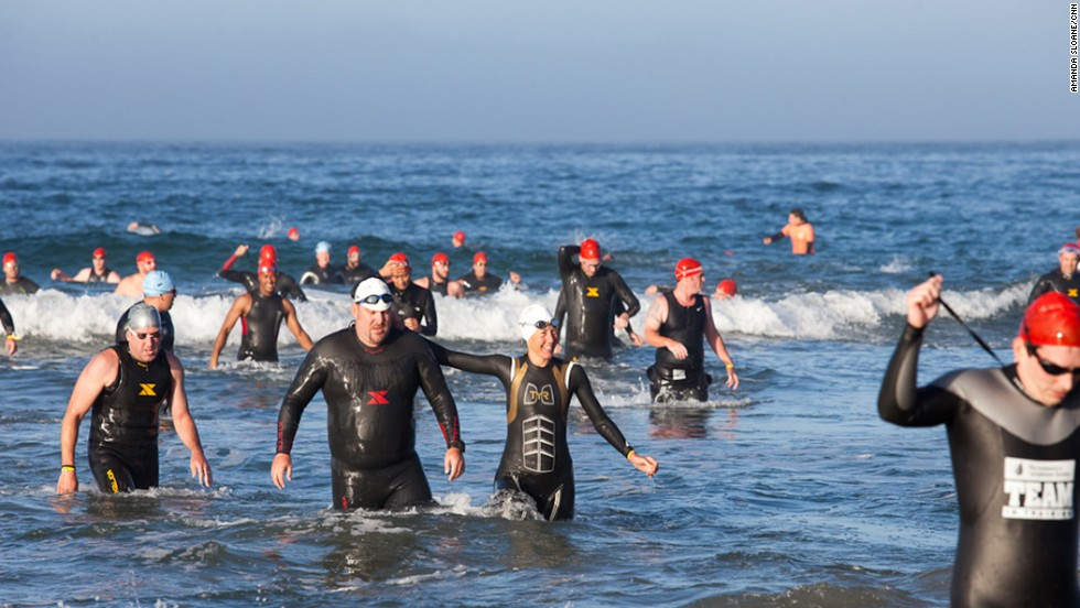 "Mantooth, second from left, exits the water after the half-mile ocean swim. He <a href=""http://ireport.cnn.com/docs/DOC-890415"">was a huge fan of triathlons</a> but had never tried doing one before joining the CNN Fit Nation team."