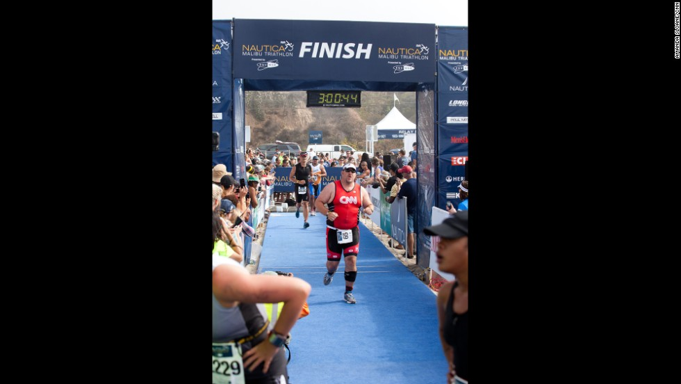 "Mantooth crosses the finish line with pride. ""I've come to understand that fitness is a journey and not a destination. And I'm just getting started,"" <a href=""http://www.cnn.com/2013/08/30/health/fit-nation-mantooth-honesty/index.html"">he says</a>."