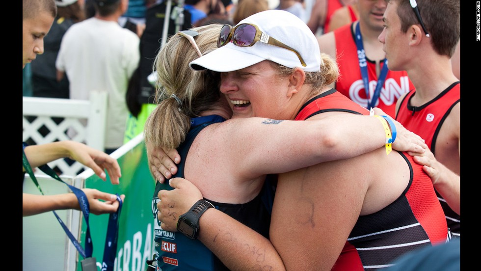 "McMahon hugs a fan after finishing the race. During her sophomore year at Indiana University, she was <a href=""http://www.cnn.com/2013/02/08/health/fit-nation-tabitha-family-love"">diagnosed with ulcerative colitis</a>, a type of inflammatory bowel disease. Since then she's had several complications and additional surgeries. She says joining the Fit Nation team has helped her regain a bit of control over her health."