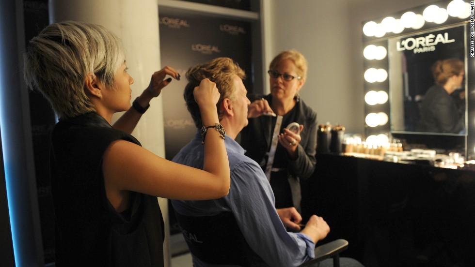 Bruce Alcock receives hair and makeup services at the Guess Portrait Studio on September 11.
