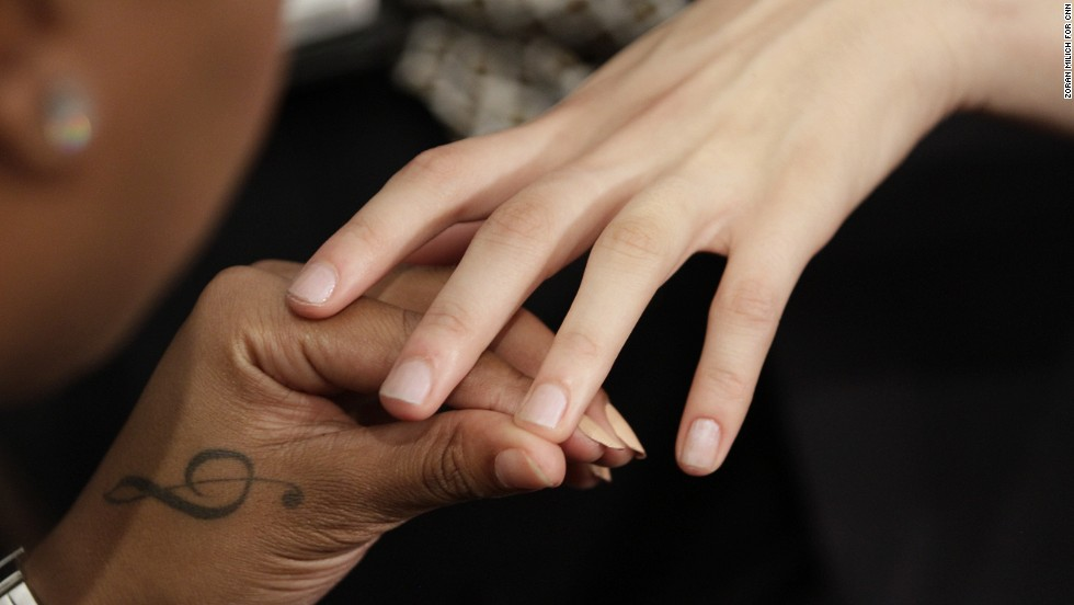 A model gets her nails done before Tadashi Shoji debuts his spring collection.