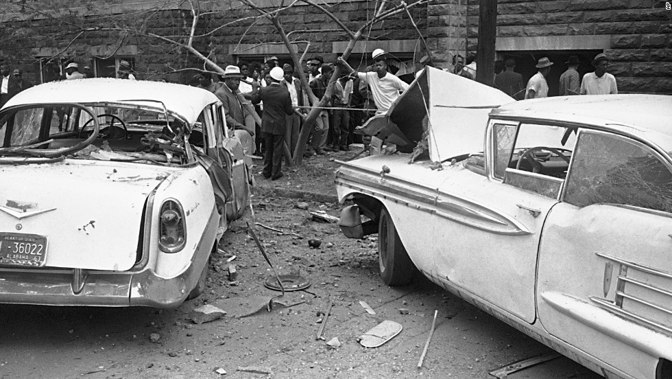 Cars parked beside the church were damaged by the blast.