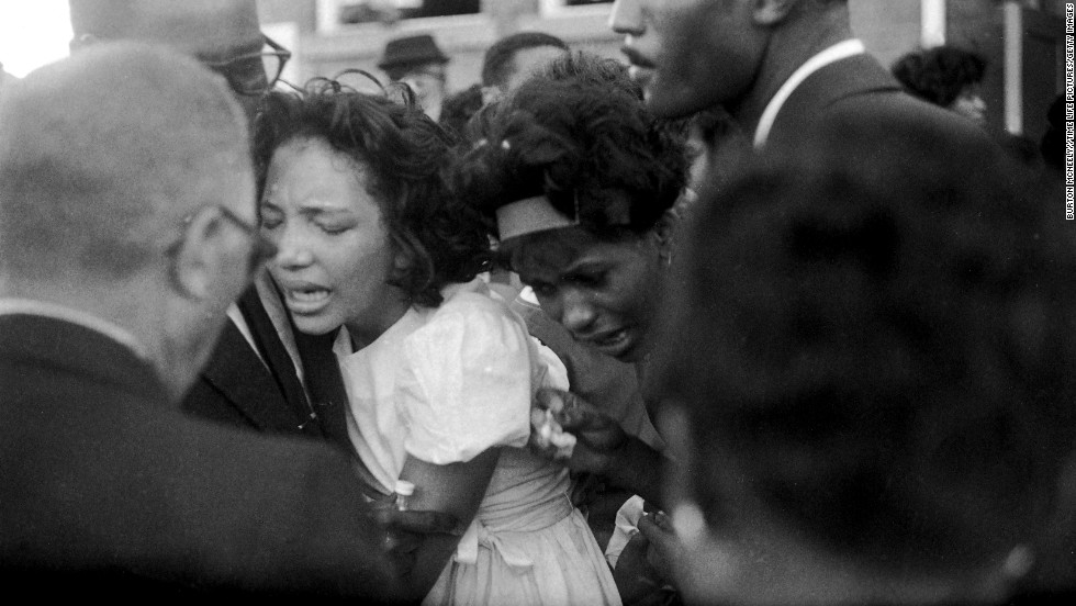 "Mourners embrace at the funeral. In his eulogy, Dr. King said, ""These children -- unoffending, innocent and beautiful -- were the victims of one of the most vicious and tragic crimes ever perpetrated against humanity."""