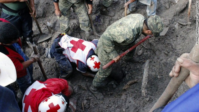 Mexican soldiers and Red Cross members look for victims of a landslide caused by heavy rains in Coscomatepec, Veracruz State, on September 10, 2013. At least nine people were killed, including four children, in the Mexican State of Veracruz by the flooding of rivers and mudslides resulting from heavy rains that affected the area, reported authorities.   AFP PHOTO / KORAL CARBALLO        (Photo credit should read KORAL CARBALLO/AFP/Getty Images)