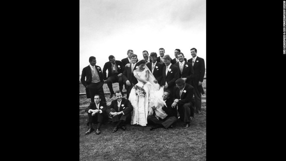 John and Jackie Kennedy are seen with groomsmen and other guests on their wedding day.