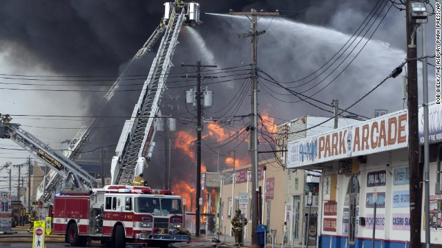 Firefighters battle a fire on the Seaside Heights, N.J. boardwalk Thursday, September 12. The fire  started in near an ice cream shop and spread throughout several blocks of boardwalk and businesses.  The area is still rebuilding from damage caused by Superstorm Sandy.