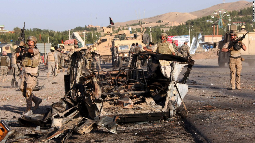 "U.S. troops led the investigation of the site of a suicide car bombing and a gunfight near the <a href=""http://www.cnn.com/2013/09/13/world/asia/us-consulate-afghanistan-attack/index.html?hpt=hp_t2"">U.S. consulate in Herat, Afghanistan</a>, on Friday, September 13. Taliban militants attacked the consulate using a car bomb and guns to battle security forces just outside the compound. An intercepted al Qaeda message led to the <a href=""http://www.cnn.com/2013/08/04/politics/us-embassies-close/index.html"">closing of 22 embassies and consulates</a> across the Middle East and North Africa on August 4. Take a look at other attacks on U.S. diplomatic sites in recent years."
