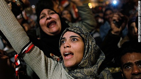 CAIRO, EGYPT - A woman cheers in Tahrir Square after it is announced that Egyptian President Hosni Mubarak was giving up power February 11, 2011 in Cairo, Egypt. After 18 days of widespread protests, Mubarak announced that he would step down.
