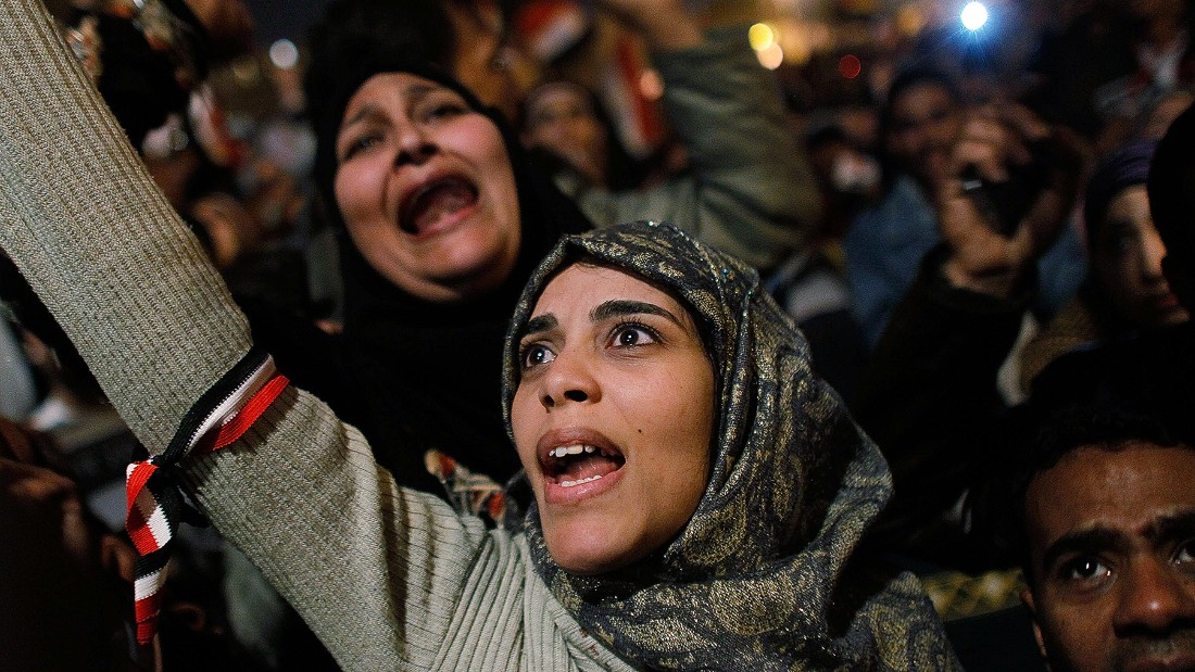 CAIRO, EGYPT: A woman cheers in Tahrir Square after it is announced that Egyptian President Hosni Mubarak was giving up power February 11, 2011 in Cairo, Egypt. After 18 days of widespread protests, Egyptian President Hosni Mubarak announced that he would step down.