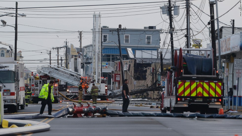 Fire officials work in the area where a massive fire burned a large portion of the boardwalk in Seaside Park, New Jersey, on Friday, September 13. CNN affiliate KYW reported that the fire started Thursday at the Kohr Brothers frozen custard shop on the FunTown Amusement Pier. New Jersey Gov. Chris Christie said 35 engine companies, 15 ladders and 400 firefighters battled the fire. The area is still rebuilding from damage caused by Superstorm Sandy.