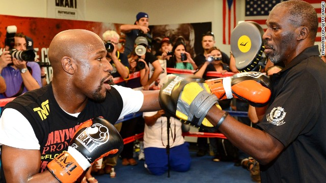 Floyd Mayweather, left, puts his unblemished 44-0 record on the line when he fights Canelo Alvarez in Las Vegas.