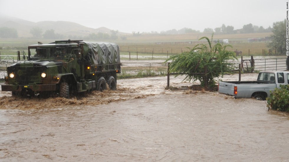 The guardsmen brought in high-clearance vehicles to take people out of the flooded areas.