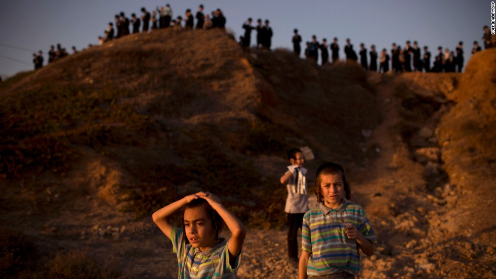 Ultra-Orthodox Jews of the Hasidic sect Vizhnitz gather on a hill overlooking the Mediterranean Sea as they participate in a Tashlich ceremony in Herzeliya, Israel.
