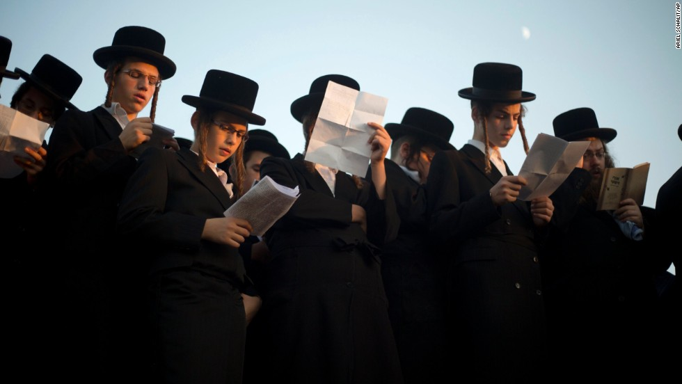 Ultra-Orthodox Jews pray on the Ayarkon River banks as they participate in a Tashlich ceremony in the ultra-Orthodox Israeli town of Ramat Gan, near Tel Aviv.