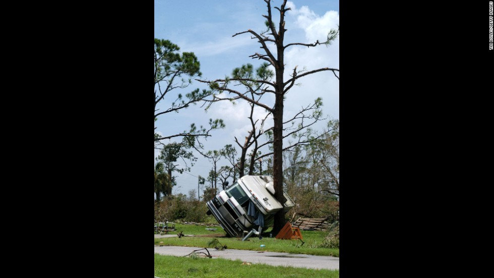 August 13, 2004, Hurricane Charley pushed ashore near Captiva Island, Florida, as a Category 4 storm with maximum winds near 150 mph. It devastated Port Charlotte and Punta Gorda, where a recreational vehicle was found resting against a tree. Charley then moved into the Carolinas to do more damage there. Overall, at least 15 people were killed. Estimated damage: $15 billion.
