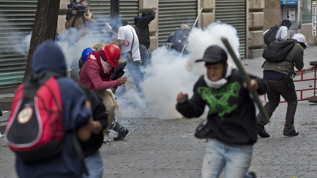 Teachers protesting against an education reform clash with the Mexican Federal Police during a violent eviction of Mexico City's Zocalo square, on September 13, 2013.