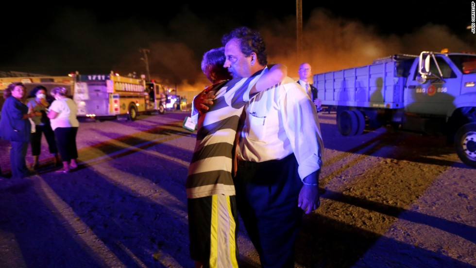 Christie is hugged by Michael Cisneros, 14, during a visit to the area hit by the massive fire on the boardwalk on Thursday, September 12.