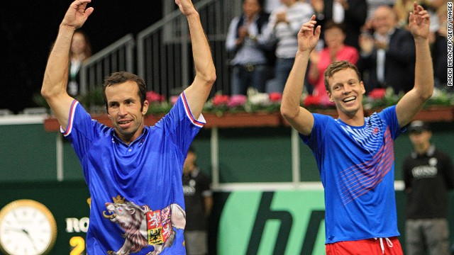 Tomas Berdych (R) and Radek Stepanek (L) celebrate after securing a 3-0 win for the Czech Republic over Argentina in Prague.