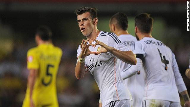 Gareth Bale's celebrates in trademark style after scoring on his Real Madrid debut against Villarreal.