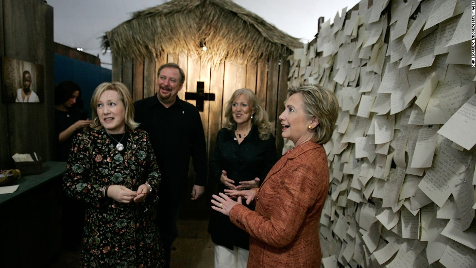 Hillary Clinton, right, then a Democratic presidential candidate, views an AIDS exhibit at the third annual Global Summit on AIDS and the Church at Warren's Saddleback Valley Community Church on November 29, 2007. All the presidential candidates were invited to attend the summit, but Clinton was the only one to attend in person.