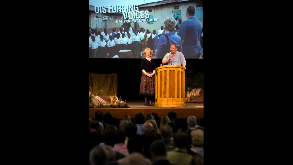 "Rick Warren and his wife, Kay Warren, open the 2005 HIV/AIDS Conference, ""Disturbing Voices,"" in 2005 at the Saddleback Church."