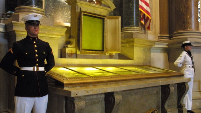 An honor guard stands next to original copies of the Declaration of Independence, the Constitution and the Bill of Rights.