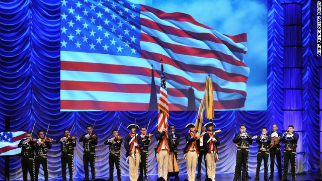 A color guard and a mariachi band share the stage at the 26th Annual Hispanic Heritage Awards in Washington on September 5.